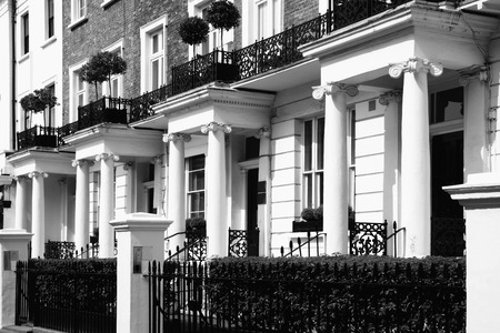 residential: Black and white monochrome photograph picture of  expensive old fashioned typical Regency Georgian terraced town houses building architecture in fashionable Notting Hill, Kensington, London, England, UK