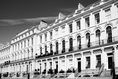 georgian: Black and white monochrome photograph picture of  expensive old fashioned typical Regency Georgian terraced town houses building architecture in fashionable London, England, UK. These residential homes are often turned into apartments or offices Editorial