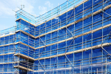 Scaffolding building frame on a building industry construction site Stockfoto