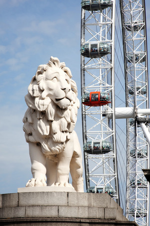millennium wheel: London UK  August 19 2012: The South Bank Lion and London Eye in Westminster on the banks of the River Thames are two popular tourist attraction