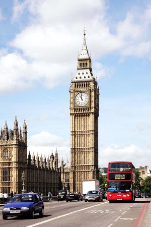 westminster bridge: London UK  May 21 2011: Traffic on Westminster Bridge passing Big Ben and the Houses of Parliamen