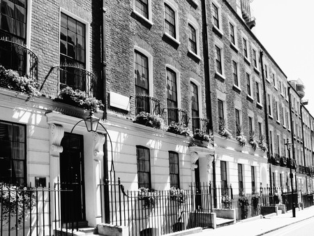 terraced: Black and white image of Regency Georgian terraced town houses in Westminster, London ,England