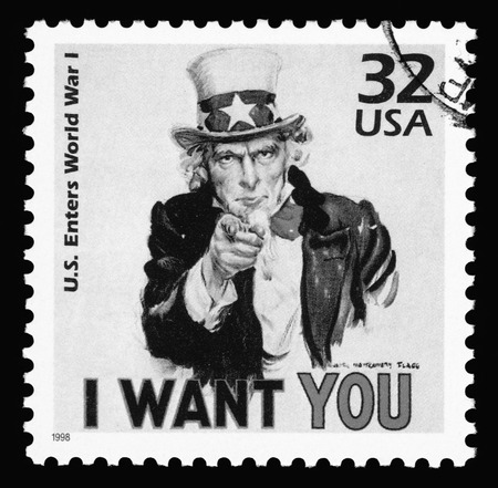 enlisting: Black  white image of a USA vintage postage stamp showing Uncle Sam from World War One  saying I want you