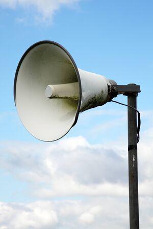 public address: Outdoors loudspeaker metal megaphone public address system Stock Photo