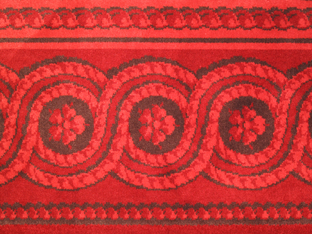 red carpet background: Old wool antique red carpet abstract border pattern background