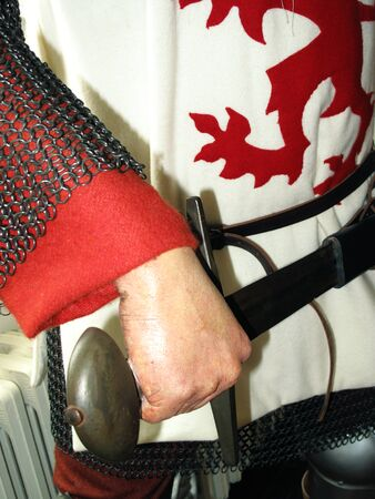 rampant: Manikin of a Medieval knight in chain mail armour bearing the heraldic lion rampant the royal standard of the king of England Stock Photo
