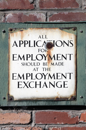 sacked: Old vintage retro distressed enamel metal application for employment sign