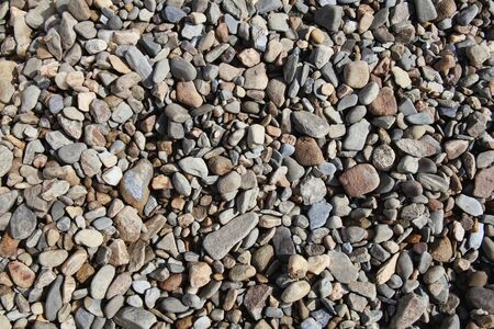 Pebble Beach: Background of rock pebble stones used for landscaping Stock Photo