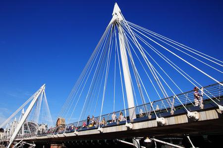 jubilee: London, United Kingdom, September 9, 2012 : Tourist crossing the Golden Jubilee Footbridges, built to celebrate the Golden Jubilee of Queen Elizabeth II