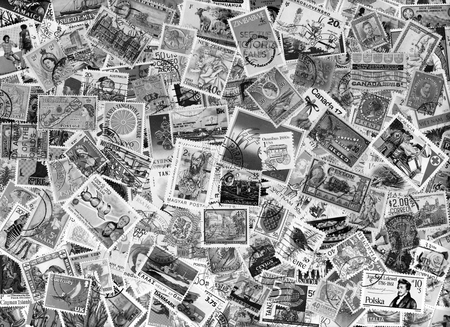 black and white image: Black  white image of a large world foreign postage stamp collection background