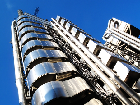 abstract london: The Lloyds Building in the heart of the financial district of London, England, UK, is the headquarters of the insurance firm Lloyds Of London