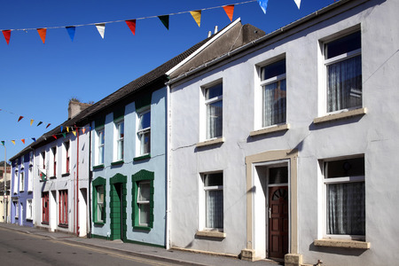 terraced: Old fashioned colourful terraced town houses in Kidwelly, Carmarthenshire, Wales, UK