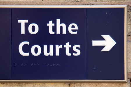 To the law courts blue direction arrow sign