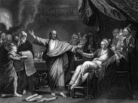 An engraved illustration image of Daniel Interpreting The Writing On The Wall , from a vintage Victorian bible dated 1852 that is no longer in copyright