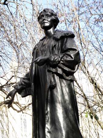 women's issues: Emily Pankhurst 1858-1928 statue in Victoria Tower Gardens at the Houses of Parliament, London England, UK, was sculptured by Arthur George Walker and unveiled ion 1930