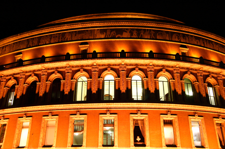 kensington: Night shot of the Royal Albert Hall, Kensington,  London, England, UK, built 1867-71 to commemorate the death of Queen Victoria beloved consort Prince Albert. It is the leading classical music venue in the country and is the home of the Proms