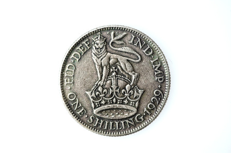 shilling: George V silver English shilling, which is now an obsolete coin of England, UK. Its value was twelve pence, one twentieth of the pound at that time Stock Photo