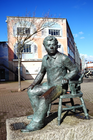 playwright: Swansea, Wales, UK, February 23, 2016 : Dylan Thomas statue which stands outside the Dylan Thomas Theatre in the Marina. Sculpted by John Doubleday it was unveiled in 1984 as a memorial to the much loved poet and writer