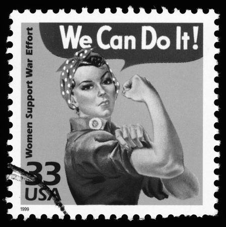 world war two: USA retro World War Two postage stamp showing an image of women support war effort, black and white image