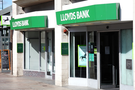 bank branch: Cardiff, Wales, UK, August 31, 2016: Lloyds bank advertising sign outside the entrance to their retail branch in Queen Street