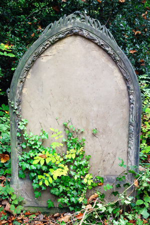 old backgrounds: Blank tombstone grave of a recent funeral burial in an old cemetery with copy space for Halloween gravestone horror death backgrounds