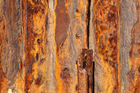 rust covered: Background of old distressed iron panels covered in rust