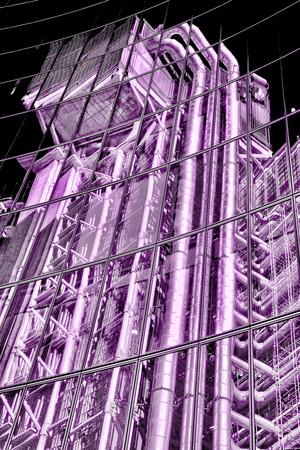 London, UK, January 14, 2012 : Monochrome tinted image of a reflection in office windows of the Lloyd's Building