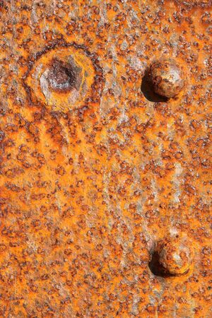 rust covered: Background of old distressed iron panel covered in rust