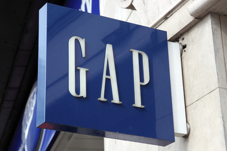 clothing stores: London, UK, April 2, 2011 : Gap logo advertising sign outside one of its clothing stores in Oxford Street Editorial