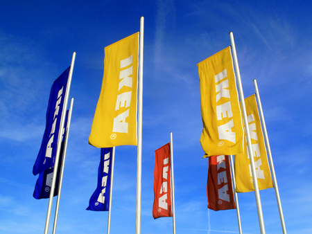 trademark: London, UK – April 6, 2011:  Ikea advertising flags outside its retail supermarket stores in Brent Park Wembley Editorial