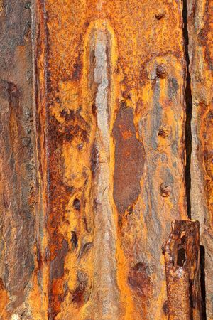 pealing: Background of old distressed iron panels covered in rust