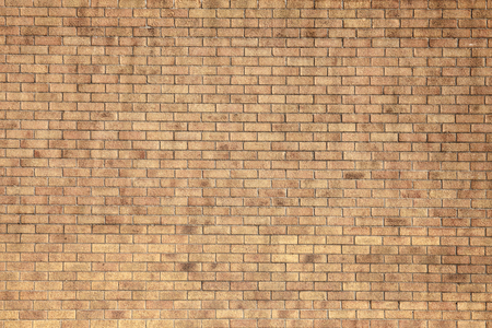 Modern large yellow brick wall background