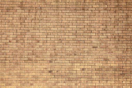 Nowoczesna duża żółta tle ceglanego muru Zdjęcie Seryjne