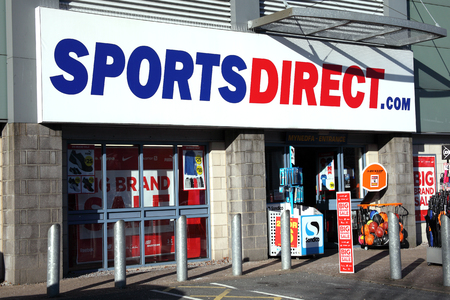 shop sign: Carmarthen, Wales, UK, January 2, 2017 : Sports Direct clothing store in the city centre during its sale season