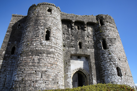 gatehouse: Kidwelly, Wales, UK, September 25, 2015 : Kidwelly Castle gatehouse by the River Gwendraeth is a ruin of a 13th century medieval castle and a popular tourist attraction Editorial