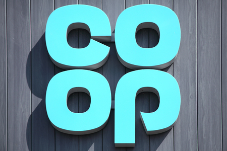 co operative: Burry Port, Wales, UK, July 1, 2017 :  Co Op logo advertising sign outside one of  its retail supermarket stores in the town centre Editorial