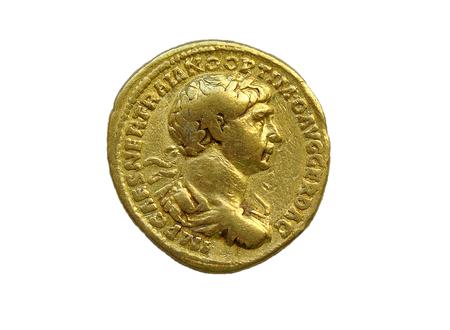 Gold Roman aureus coin of Roman emperor Trajan AD 98-117 isolated on a white background Archivio Fotografico