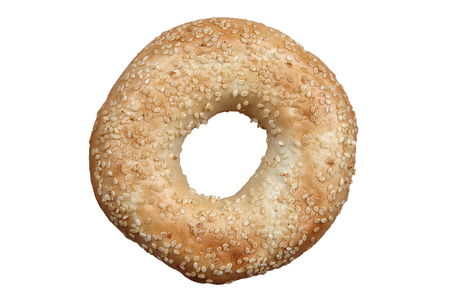 roll out: Sesame seeded bagel bread roll isolated on a white background