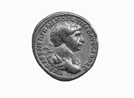 Gold Roman aureus coin of Roman emperor Trajan AD 98-117 isolated on a white background as a black and white image Stock Photo