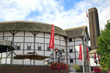 globe theatre: London, UK – July 30, 2009 : The  Globe Theatre advertising tours and exhibitions with banners which is a popular visitor attraction of the city