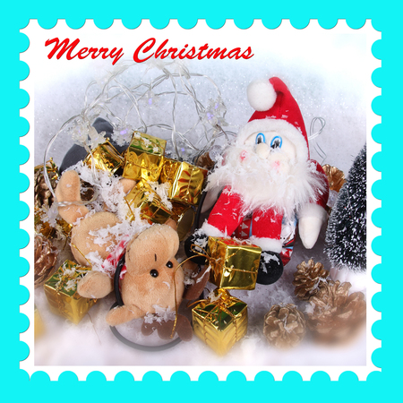 Christmas postage stamp design with half tone photograph of Santa Claus, reindeer and present gifts Stock Photo