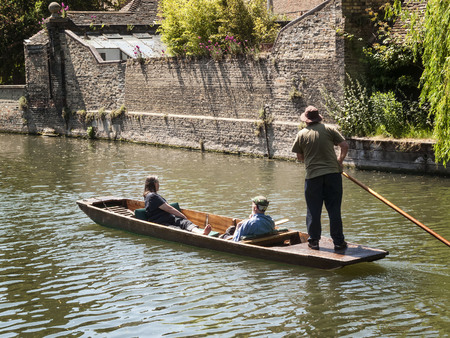 Cambridge, UK, May, 31 2009 :  Tourist punting on the River Cam which is a popular visitor industry of the city