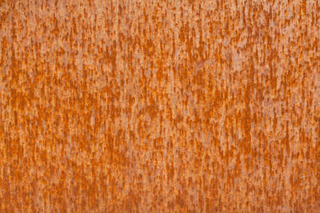 Background of old distressed iron panel covered in rust