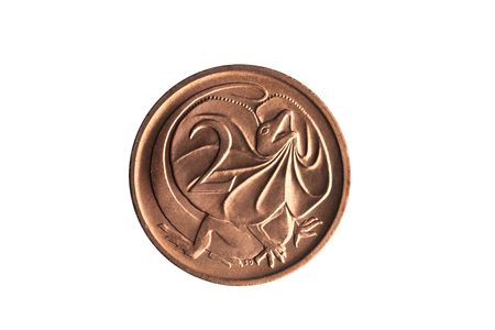 Australia two cent coin with an image of a Frill Necked Lizard cut out and isolated on a white background