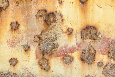 Rust covered weathered iron steel metal background with rusty peeling blistering paint Standard-Bild - 112456091