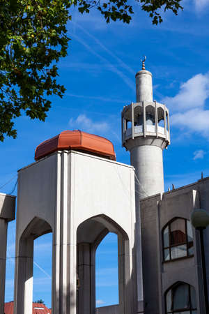 Minaret of the London Central Mosque or the Islamic Cultural Centre in Regents Park England UK a popular Islam travel destination tourist attraction landmark stock photo image