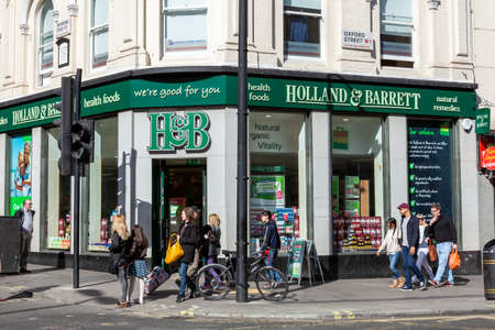 London, UK, April 1, 2012 : Holland & Barrett logo advertising sign outside its business retail store which sells health benefit products and a stock photo image Stock fotó