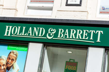 London, UK, April 1, 2012 : Holland & Barrett logo advertising sign outside its business retail store which sells health benefit products and a stock photo image