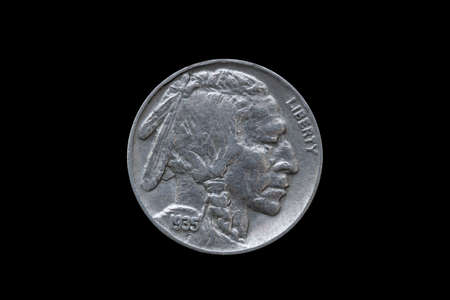 USA five cents Buffalo Indian Head nickel coin dated 1935 cut out and isolated on a black background, stock photo image