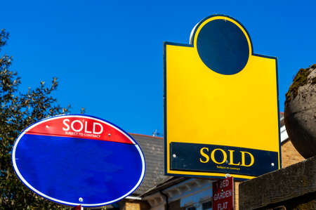 Generic blank estate agent house for sale sold sign for use during the booming home ownership housing property market with copy space, stock photo image